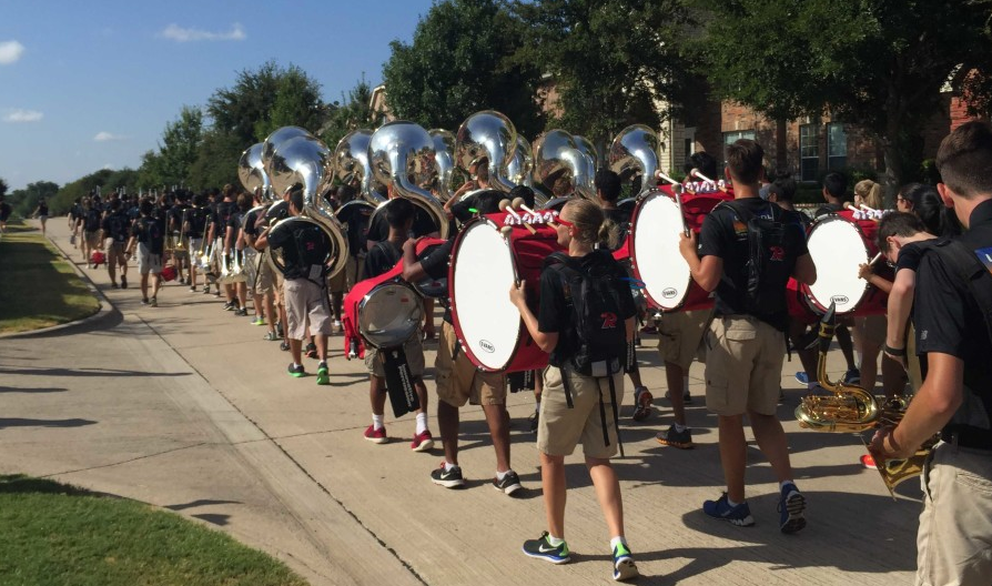 From+marching+in+the+streets+as+part+of+a+fundraiser+to+performing+at+halftime+of+football+games%2C+the+band+has+a+full+schedule+in+the+fall.+Helping+to+lead+the+band+are+the+drum+majors+who+act+as+a+intermediary+between+the+band+and+the+band+directors.