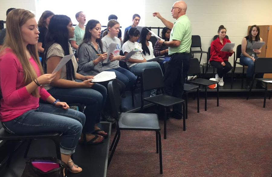 For+nine+years+choir+director+Bruce+Stevenson+has+been+working+with+high+school+students.+This+week+he+is+helping+them+prepare+for+All-State+auditions+on+Thursday.+