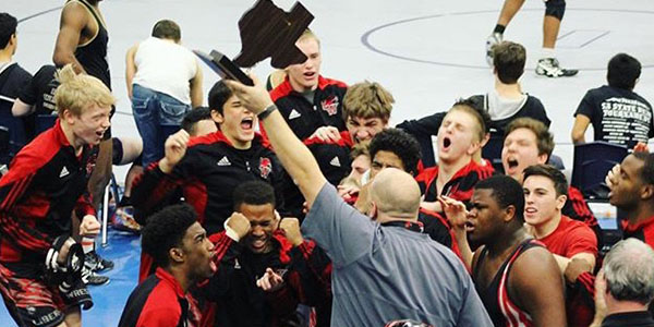 Hosting the trophy above his head as the team celebrates, wrestling coach Jason Thurston guided the boys' to 2016 State Dual Championship by defeating wrestling team defeated Centennial 36-27. (Jan. 16, 2016)
