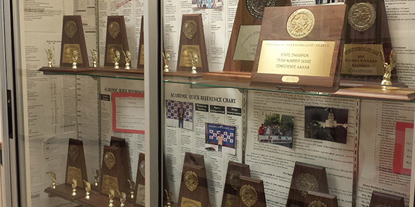 Campus UIL director Jeff Schrantz hopes to add another trophy to this display case with a strong performance at the UIL Academic State Meet April 21-22 at UT Austin.