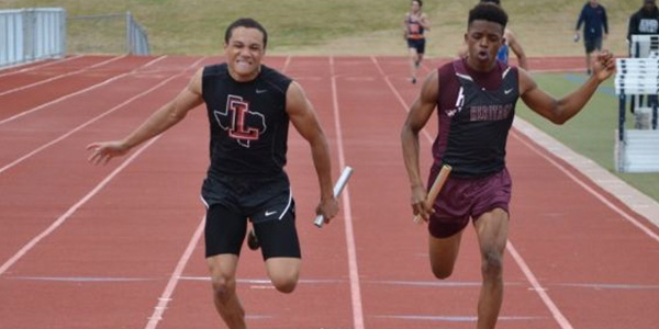 Isaiah Palmer (left) placed second in the 400 meter run at the state meet.