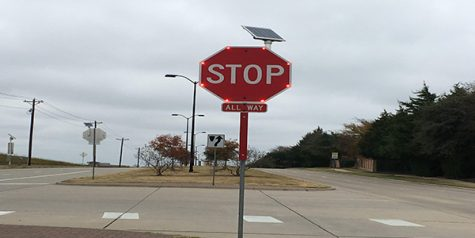 Flashing stop sign catches attention at intersection
