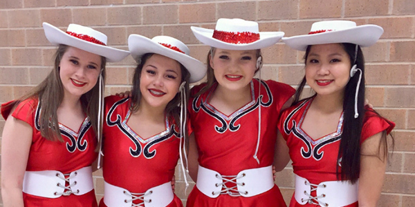 First from the left, freshman Emma Hancock smiles with her fellow dancers after the 2017 Spring Show.
