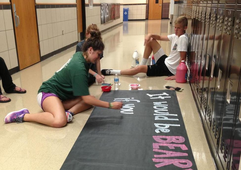 StuCo members go to much preparation for Homecoming, including making signs to hang throughout the school.