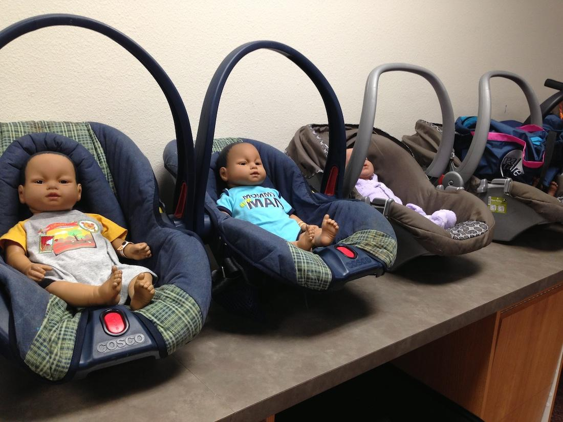 Students learn to care for infants with baby simulators in the child development class.