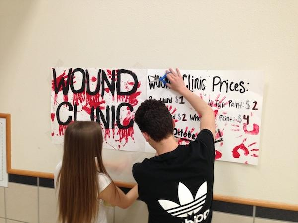 LHS theater students went to various efforts to promote the wound clinic for Halloween.