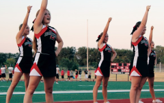 The cheerleading team encourages the crowd at Redhawk Rally.