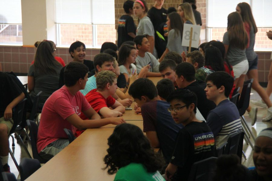 Freshmen gather in the cafeteria with their friends before the tour and presentations begin. (August 14, 2015)