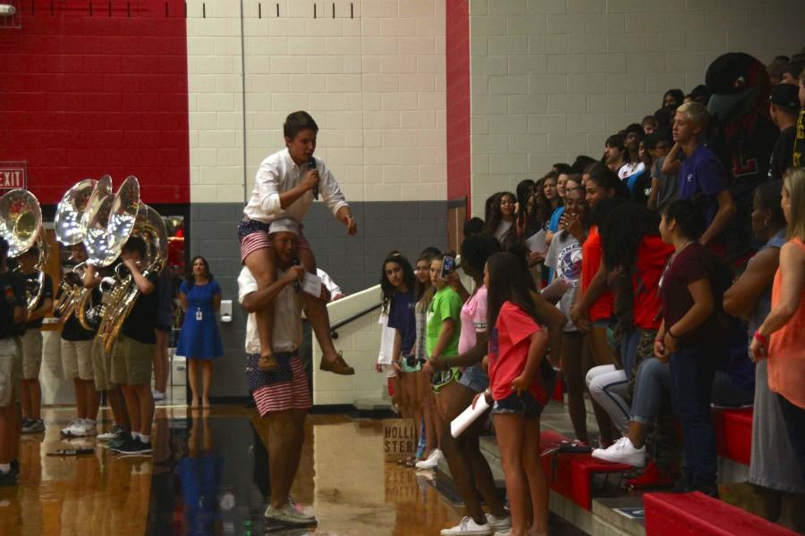Student+Council+President+Jay+Schaegel+and+Student+Council+member+Brandon+Steele+make+their+entrance+as+pep+rally+emcees.