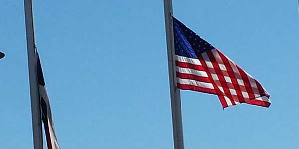 Flags in front of the school are at half staff in recognition of Patriot's Day.