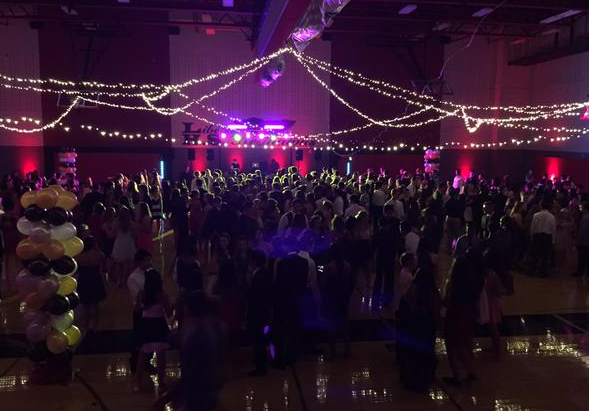 Hundreds of students fill the gym on homecoming night for an