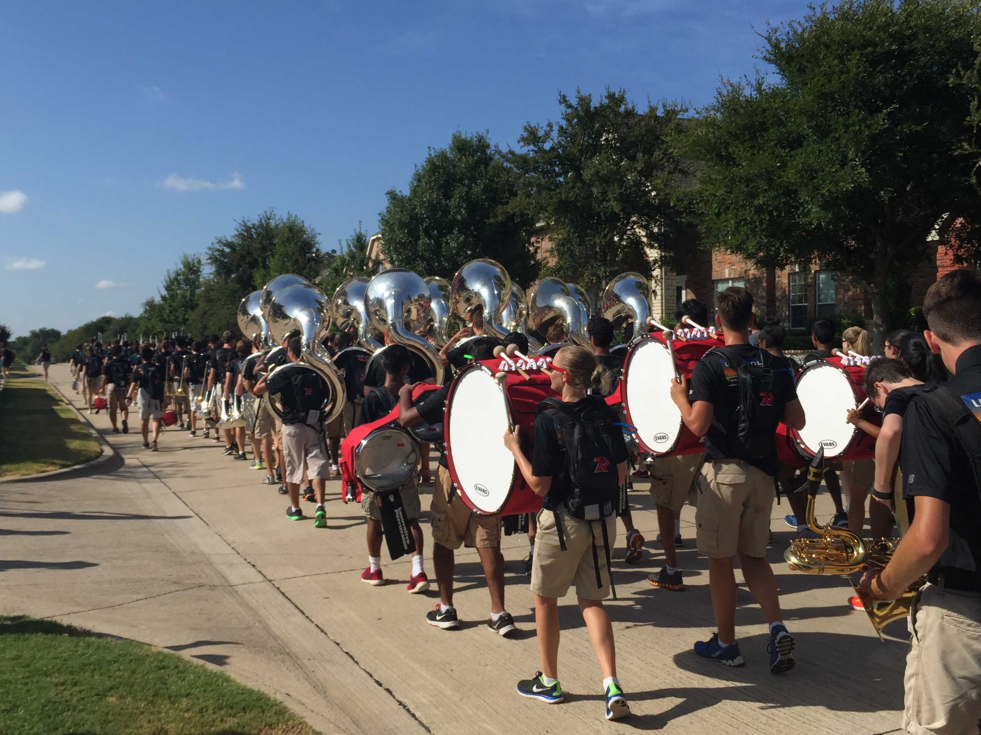 The band marched through the neighborhoods and played show music and mini concerts hoping to raise money for the year.