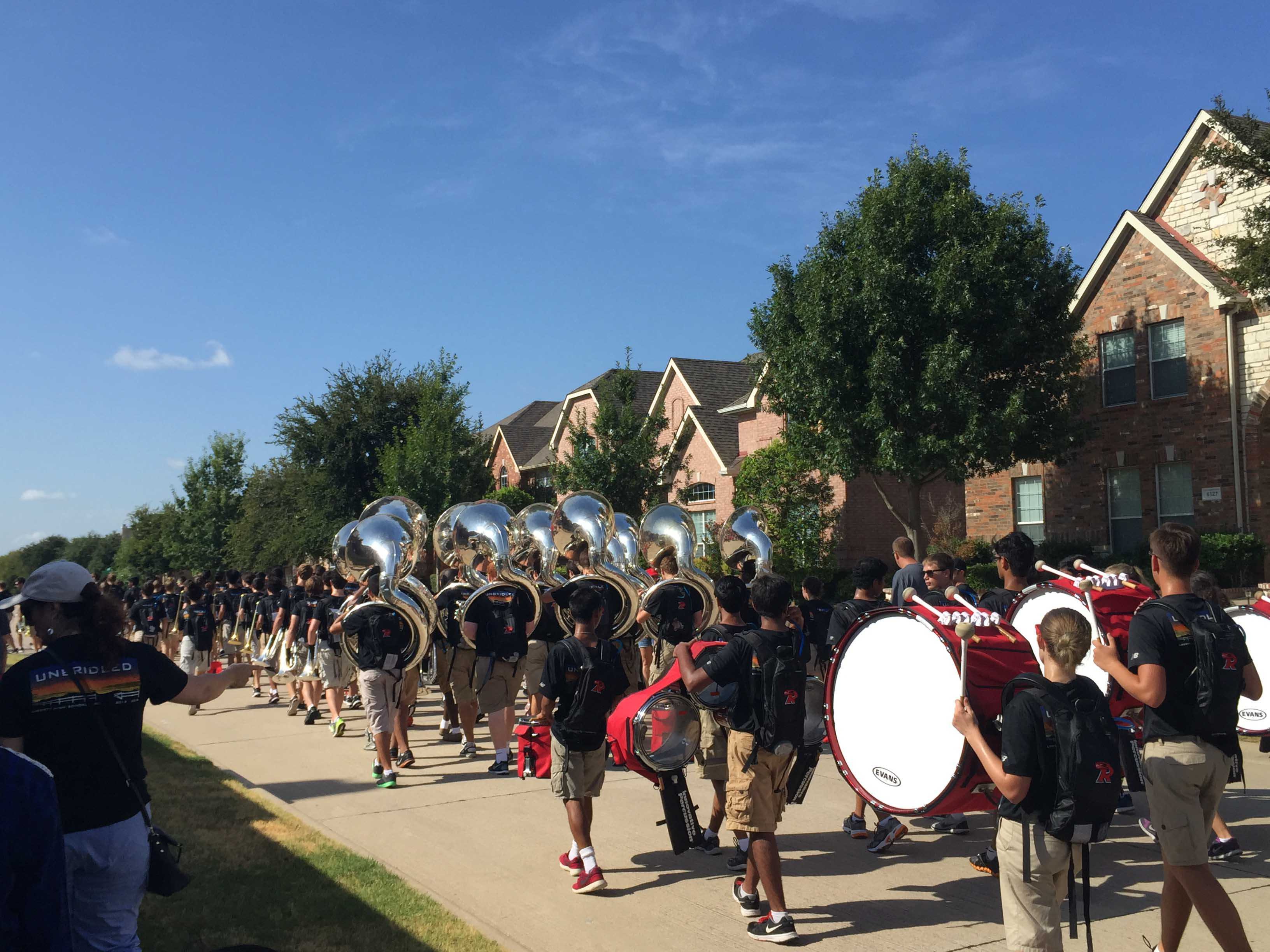 After playing at performing at Friday's football game in McKinney, the band took to local neighborhoods less than 12 hours later for its annual March-a-thon.