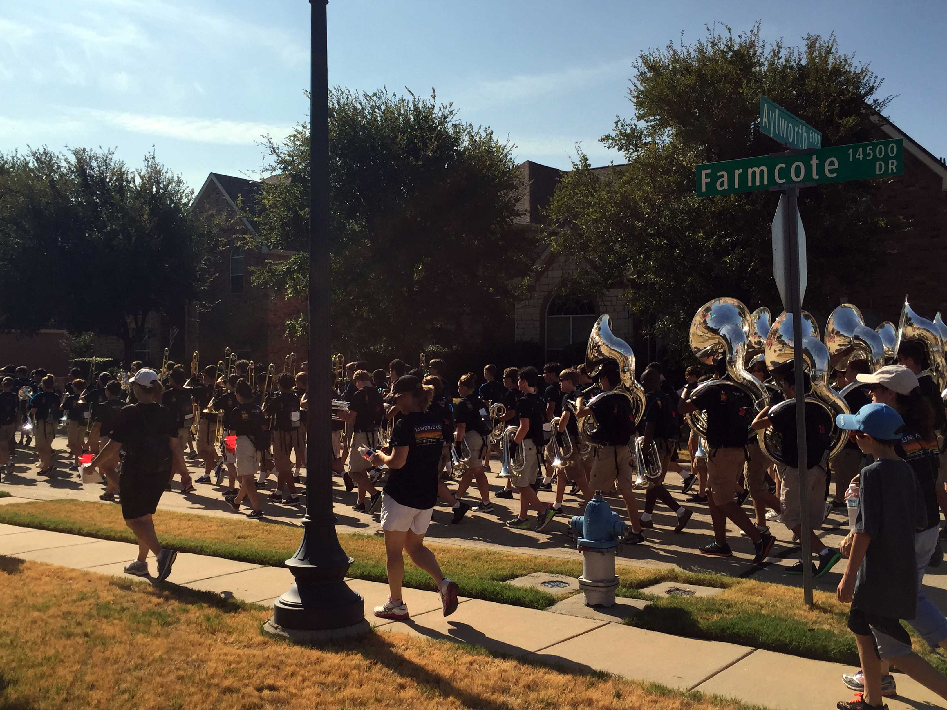 As part of its annual March-a-thon fundraiser, the band spent Saturday morning marching through local neighborhoods including a stroll down Farmcote Drive.