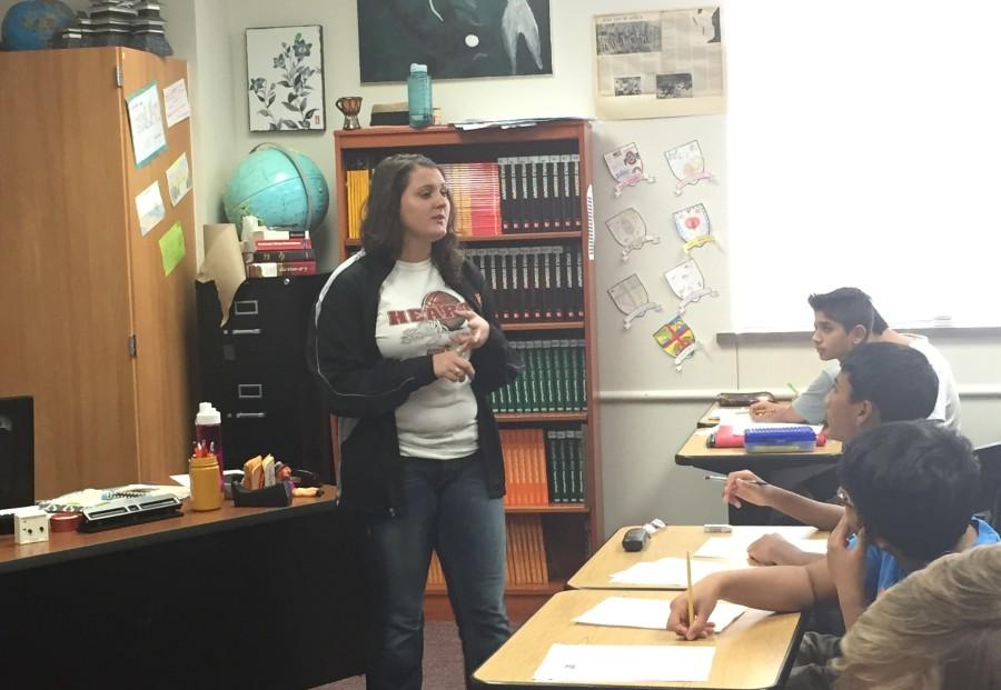 Coach Kristin Binyon instructs her World Geography class on an assignment. Parents will have the opportunity to meet teachers and learn about their classes on Meet the Teacher Night.