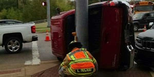 A Frisco fireman checks out the accident scene at 121 and Independence.