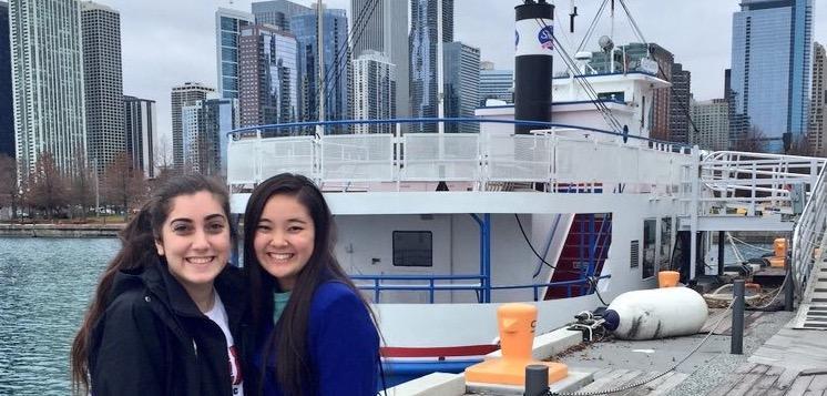 Junior+Melina+Kehtar+and+senior+Shiori+Naito+pose+on+the+dock+of+a+Chicago+harbor.