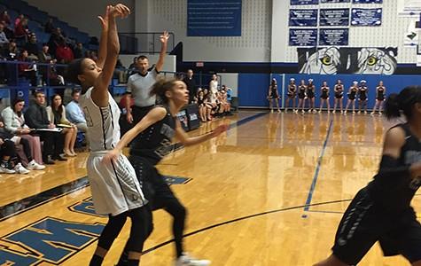 Girls' basketball wins in opening round of playoffs