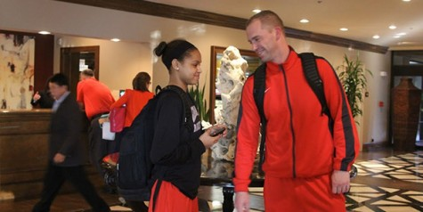 Head basketball coach Ross Reedy talks to junior Jordan Hamilton in the hotel lobby.