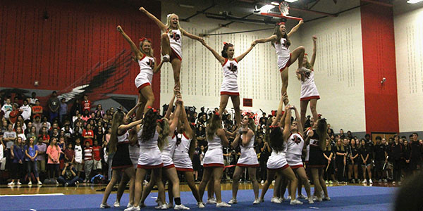 Senior Katie Stephenson has been cheering since she was in fifth grade and competes on the school's varsity cheer team.