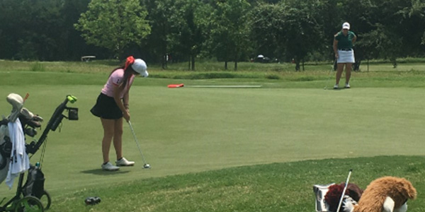 Lining+up+her+putt+at+the+5A+golf+state+championship+in+2016%2C+then+junior+Loren+Matrone+helped+the+girls%27+golf+team+to+a+5th+place+finish.+
