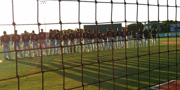 Lining up along the first baseline, the baseball team stands for the national anthem before Friday's opening round playoff game against Prosper at Plano West. The team would go on to lose the game 10-1 and the series 2-0.