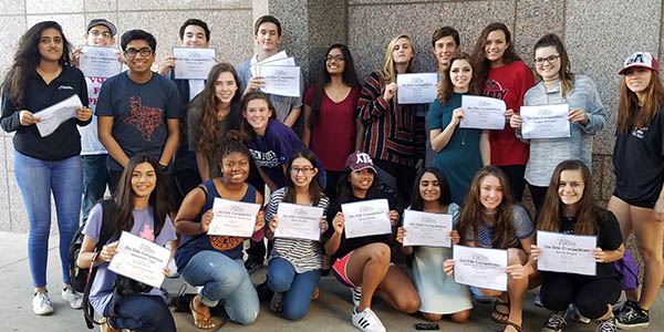 Journalism students pose with their honors certificates at the end of the TAJE Fall Fiesta convention in San Antonio. Students received a total of 17 honors with LibertyWingspan receiving both online and broadcast honors.