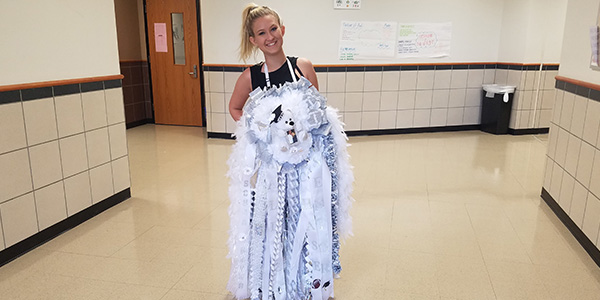 Wearing one of the biggest mums on campus this year, senior Hallie Hunter shows off the type that annoys students such as columnist Dea-Mallika Divi.