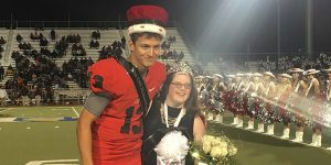 Named Homecoming King, Buss poses for a picture with Queen senior Cameron Robbins.