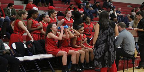 Girls' basketball claims share of championship