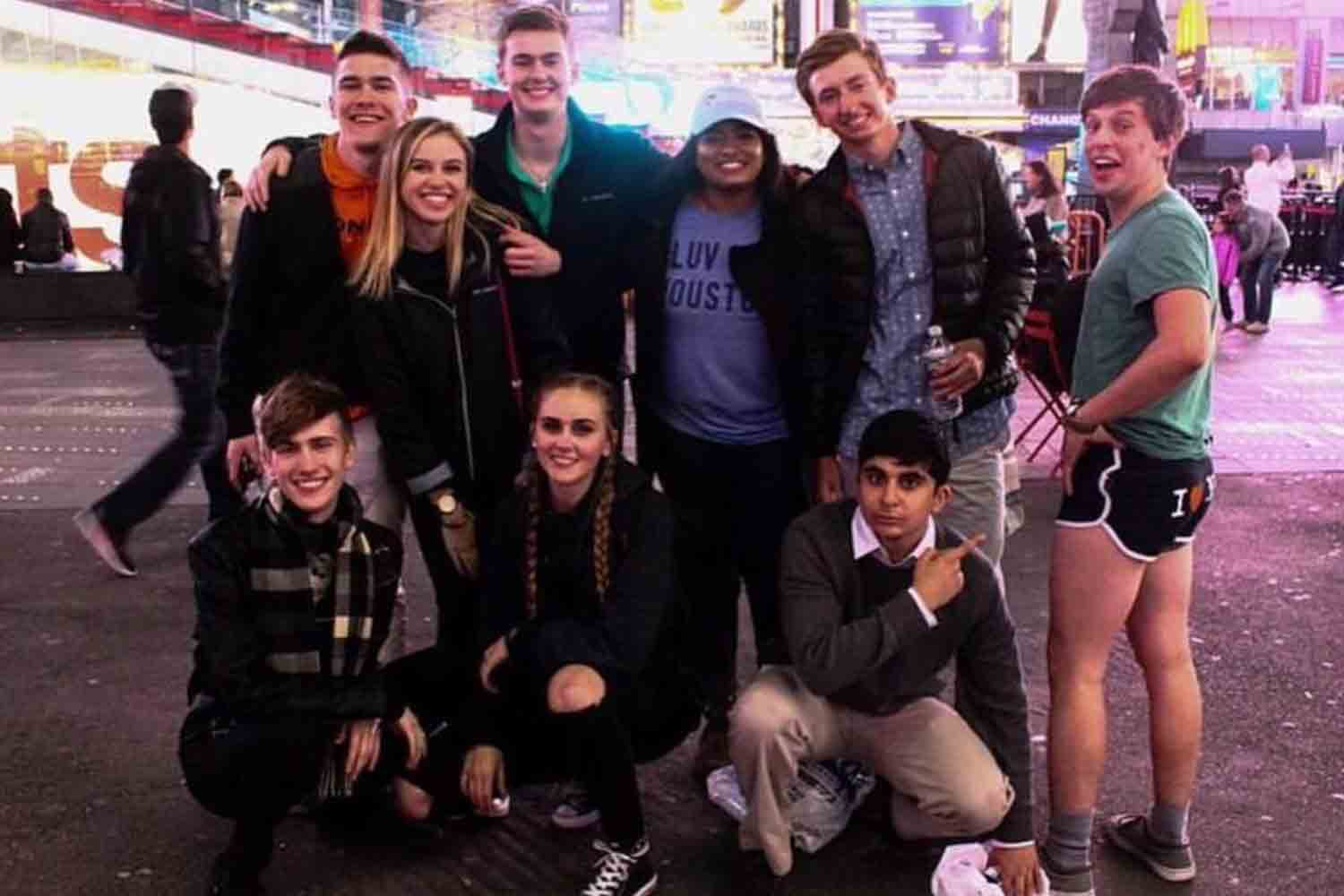 Standing in Times Square on March 17, 2016, Wingspan staff members pose for a group picture on their last night in the Big Apple after receiving a 2016 CSPA Silver Crown Award. FRONT ROW: Henry Youtt, Maddie Owens and Arman Kafai. BACK ROW: Josh Gray, Halle Barham, Alex Moore, Sarah Philips, Chase Fritz and Jay Schlaegel.
