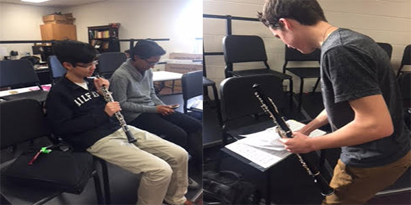 Sophomore Richard Huang (left) and Junior Marshall Mixon (right) prepare to practice during a rehearsal.
