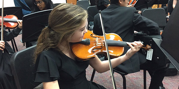 Practicing for Wednesday's UIL competition, freshman Caroline Attmore is in the Sinfonia Orchestra, one of five orchestras on campus taking part in UIL competitions Wednesday through Friday at Lebanon Trail High School.