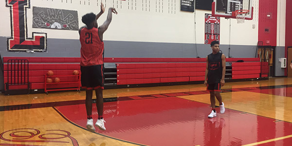 Taking a 3-point shot during practice, sophomore Zion Richardson is one of just two sophomores on the boys' varsity squad.