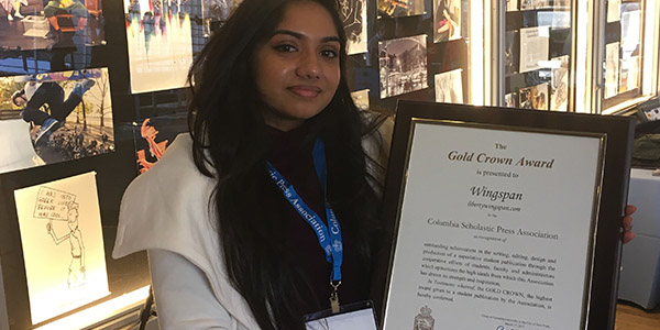 Holding Wingspan's Gold Crown plaque, junior Divya Murali was in New York City to receive the award at Columbia University. This year, a total of 1,100 publications were eligible for judging in the 2017 Crown Awards program.