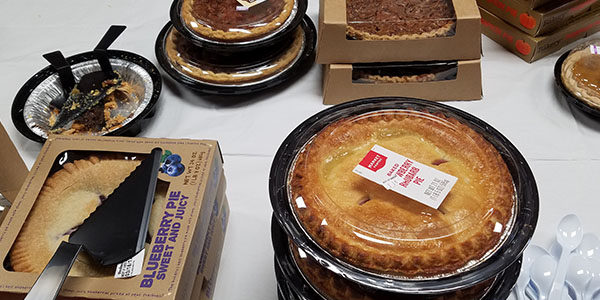 A table in the teacher's mailroom featured more than two dozen pies as part of the Math Honors Society Pi Day celebration.
