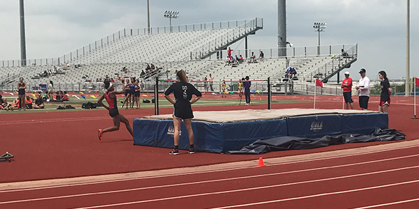 Making her approach at the 2017 district meet, then sophomore Nissi Kabongo gets ready to attempt the high jump at Memorial Stadiium on April 13, 2017.