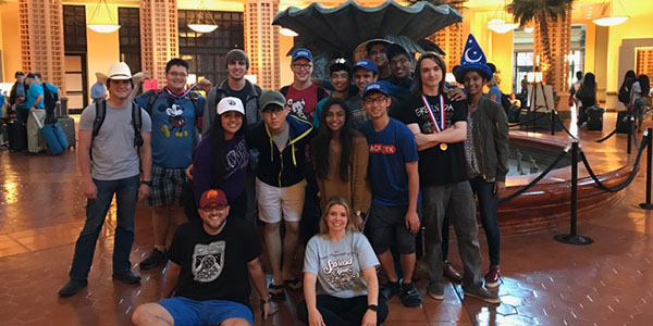 Holding is 2nd place medal while wearing his Mickey Mouse t-shirt, senior Nick Lovan (standing 2nd from the left) poses with other BPA students from the district that traveled to the national conference May 10-14. Lovan took 2nd in the Network Administration Using Microsoft competition.