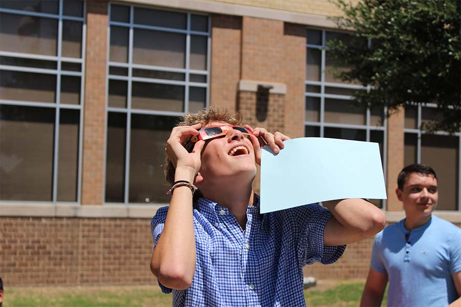 Donning eclipse glasses, physics students check out the solar eclipse on Monday, Aug. 21, 2017.