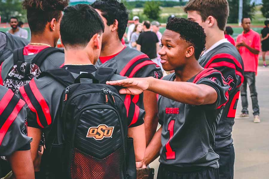 Teammates Danny Marroquin (left) and Blake Battles (right) talk during  Redhawk Rally on Saturday, Aug. 19, 2017.