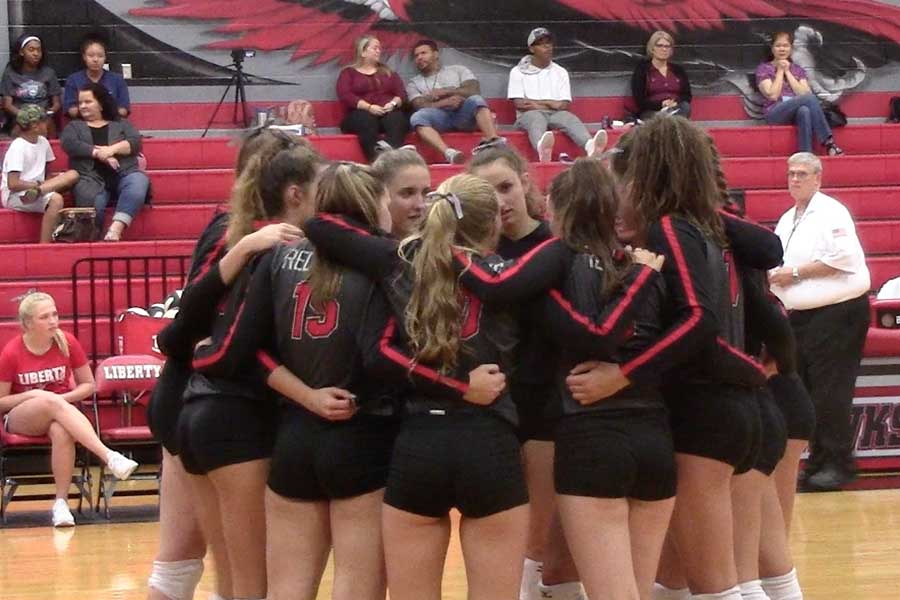 Facing+off+against+Lewisville+on+Aug.+22%2C+2017%2C+the+volleyball+team+huddles+during+a+quick+break+during+the+action.+The+Redhawks+are+back+in+action+Tuesday+when+they+take+on+Lewisville+at+home.+