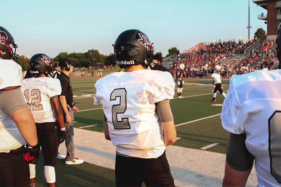 Senior+quarterback+Carson+Morris+watches+the+game+from+the+sidelines+as+he+waits+to+go+back+in.