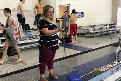Nightingale settling in as swim coach