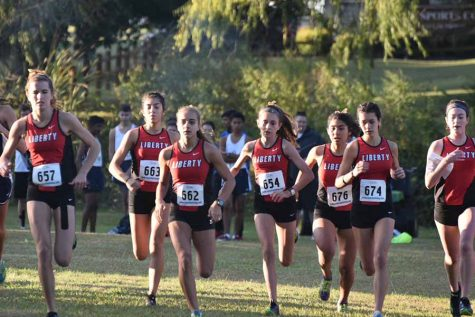 Girls' cross country takes 1st at district meet