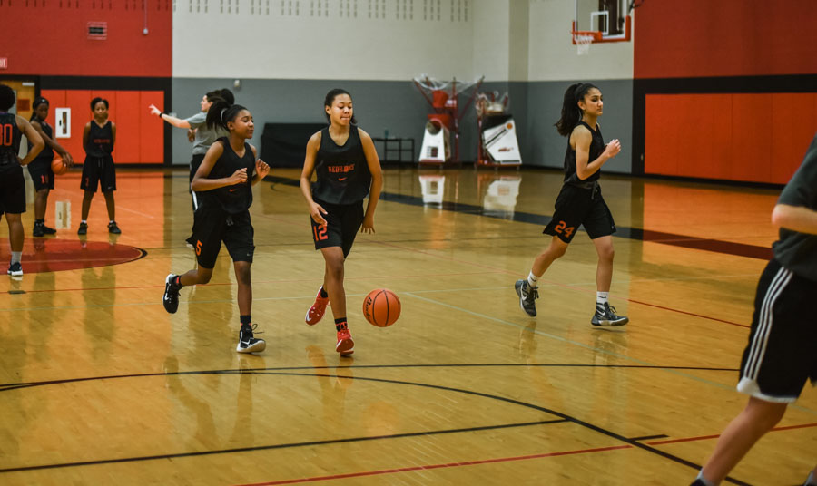 Running drills at a recent practice, the girls' basketball team, as well as the boys' team, will be practicing and playing over the Thanksgiving break.
