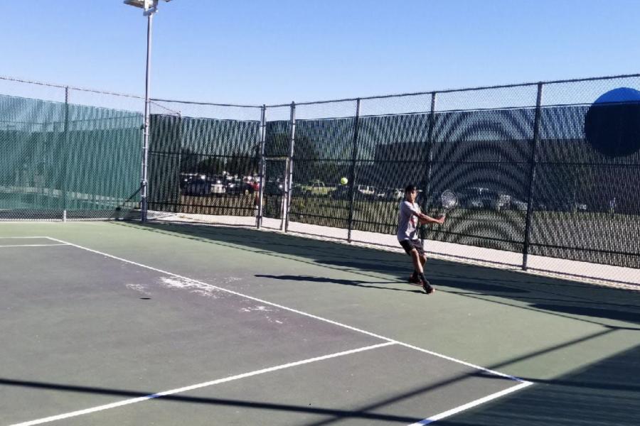 Senior+Sourya+Narala+playing+a+tennis+match+on+Tuesday.