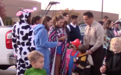 Hundreds of children and their families made their way through the band parking lot and dozens of cars filled with treats.
