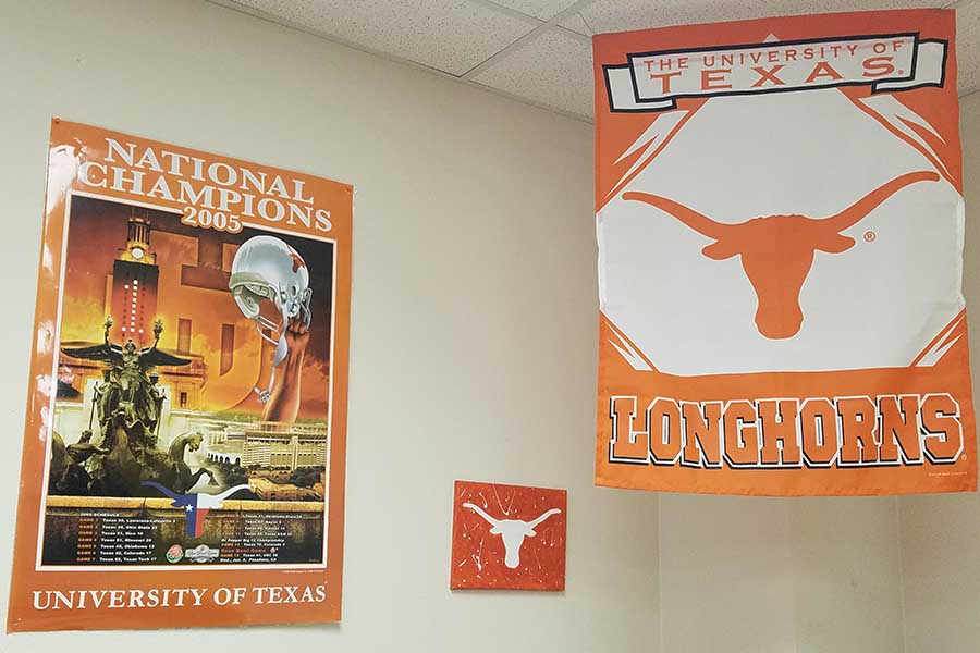 A UT banner and poster adorn the walls of social studies teacher Gary Mumford but getting into the top public university in Texas will be a bit harder starting with the class of 2019 as automatic acceptance is being lowered from the top 7 to the top 6 percent.