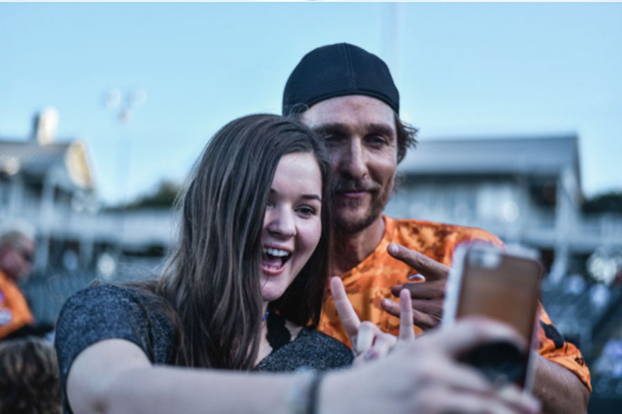 Wingspan's Keegan Williams takes a selfie with McConaughey after an interview.