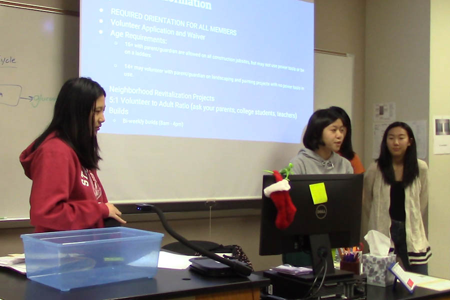 Starting this year, the Habitat for Humanity club hopes to raise money to go towards building homes for those in need. Sophomores Kate Liang, Christine Le and Jessie Rho (left to right) addressed club members at their first meeting on Thursday, Oct. 5, 2017.